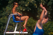 Sunbathers and a lifeguard enjoy the poolside during the August heatwave, on 20th August 1995, at Brockwell Lido, Herne Hill, London, England.
