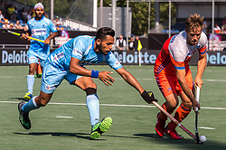 (L-R) Harmanpreet Singh of India, Jeroen Hertzberger of The Netherlands during the Champions Trophy match between the Netherlands and India on the fields of BH&BC Breda on June 30, 2018 in Breda, the Netherlands