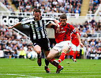 Photo: Back Page Images. 25/09/2004.<br /> Barclays Premiership. Newcastle United v W.B.A.<br /> Andy O'Brian is too late to stop Jason Koumas getting his shot on target.