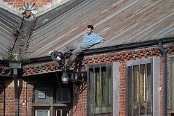 © Licensed to London News Pictures . 15/09/2015 . Manchester , UK . STUART HORNER kicks a CCTV camera on the roof at HMP Manchester (formerly Strangeways Prison ), this morning (15th September 2015) . Photo credit : Joel Goodman/LNP