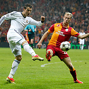 Galatasaray's Semih Kaya (R) and Real Madrid's Cristiano Ronaldo (L) during their UEFA Champions League Quarter-finals, Second leg match Galatasaray between Real Madrid at the TT Arena AliSamiYen Spor Kompleksi in Istanbul, Turkey on Tuesday 09 April 2013. Photo by Aykut AKICI/TURKPIX