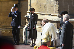 The Duchess of Cambridge bows her head at the Galilee Porch of St George's Chapel, Windsor Castle, Berkshire, during the funeral of the Duke of Edinburgh. Picture date: Saturday April 17, 2021.
