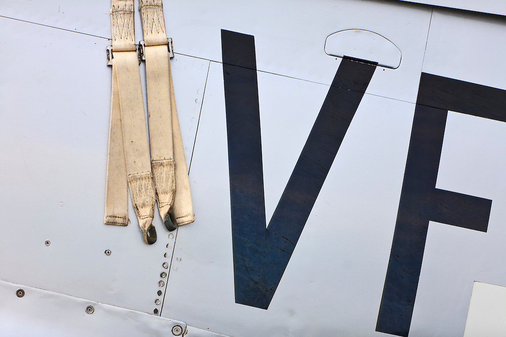 """Fuselage and harness detail of a P-51D """"Mustang"""" fighter plane on the ramp at Atlanta's PDK airport.  Owned and operated by the Dixie Wing of the Commemorative Air Force."""