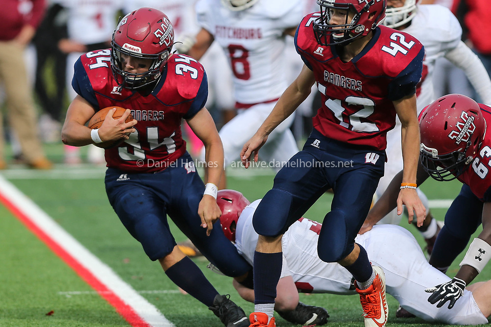 (10/13/18, WESTBOROUGH, MA) Westborough's James Hight drags a defender to pick up a few extra yards during the football game against Fitchburg at Westborough High School on Saturday. [Daily News and Wicked Local Photo/Dan Holmes]