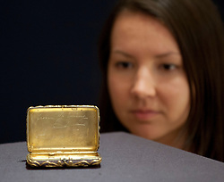 © Licensed to London News Pictures. 31/05/2013. London, UK. A Bonhams employee is seen with a jewelled Faberge cigarette case (c. 1897; est. GB£150,000-200,000), a gift from the Russian Empress Alexandra to Nicholas II - the last Tsar of the Russian Empire - on the occasion of the birth of their second daughter, at the press view for a sale of Russian art in London today (31/05/2013). The Russian sale, one of two held each year by Bonhams dedicated Russian Department  is set to take place on Wednesday the 5th of June.. Photo credit: Matt Cetti-Roberts/LNP