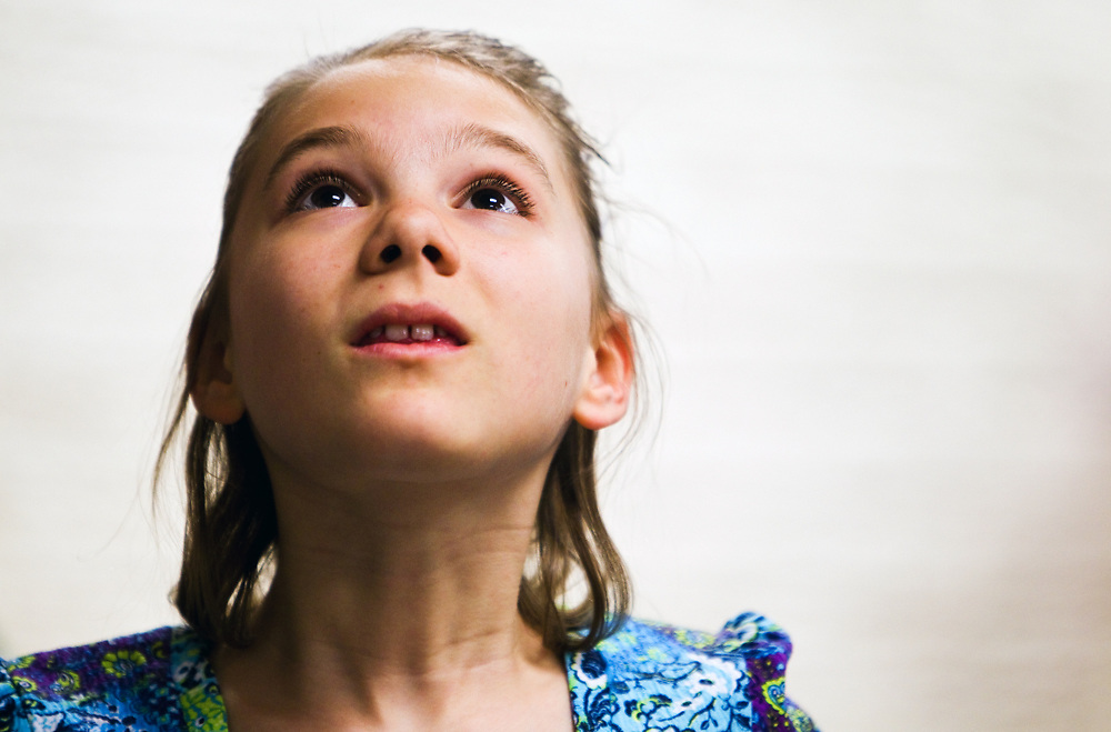 Molly Milner, 10, looks up for a moment during class Thursday at Gates School. Although Molly and her family have been dealing with symptoms of autism since she was very little, it wasn't until age 8 that she was diagnosed. (Independent/Matt Dixon)