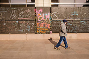 02 APRIL 2021 - MINNEAPOLIS, MINNESOTA: Pedestrians walk past plywood sheets put over windows in downtown Minneapolis. Many downtown businesses have boarded their windows during the trial Derek Chauvin murder trial. They are afraid there will be violent protests if Chauvin is acquitted. Protesters are keeping a 24 hour presence in front of the Hennepin County Courthouse in Minneapolis during the murder trial of former Minneapolis Police Officer Derek Chauvin. Chauvin is on trial for murdering George Floyd in 2020. Floyd's death, while restrained and in police custody, set off a summer of racial justice protests across the United States.      PHOTO BY JACK KURTZ