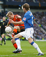 Christian Kalvenes Dundee Utd challenges  Rangers' Kirk Broadfoot in the CIS Cup Final 16/03/08