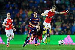 Mathieu Flamini of Arsenal fouls Andres Iniesta of Barcelona  - Mandatory byline: Matt McNulty/JMP - 16/03/2016 - FOOTBALL - Nou Camp - Barcelona,  - FC Barcelona v Arsenal - Champions League - Round of 16