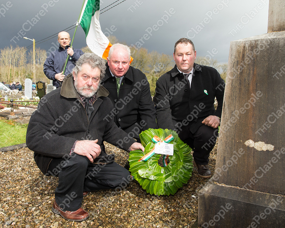Tom McDonagh, Ardnacrusha, Christopher McCarthy, Mullagh, a grand nephew of Irish Volunteer Captain Christopher McCarthy and Tom Gleeson, Meelick, a grand nephew of Irish Volunteer Captain Michael Gleeson, laying a wreath at the graves of the Irish Volunteers killed during the War of Independence at Meelick Church