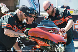 Mike and Laura Elkin of Northfield, NH take a 2017 Harley-Davidson CVO Street Glide out for a test ride after getting some instructions from Justin Stahl (L) and Mitch Deprey (R), both fabrication engineers at the York, PA Harley-Davidson plant. Photographed during Laconia Motorcycle Week, New Hampshire, USA. Wednesday June 14, 2017. Photography ©2017 Michael Lichter.
