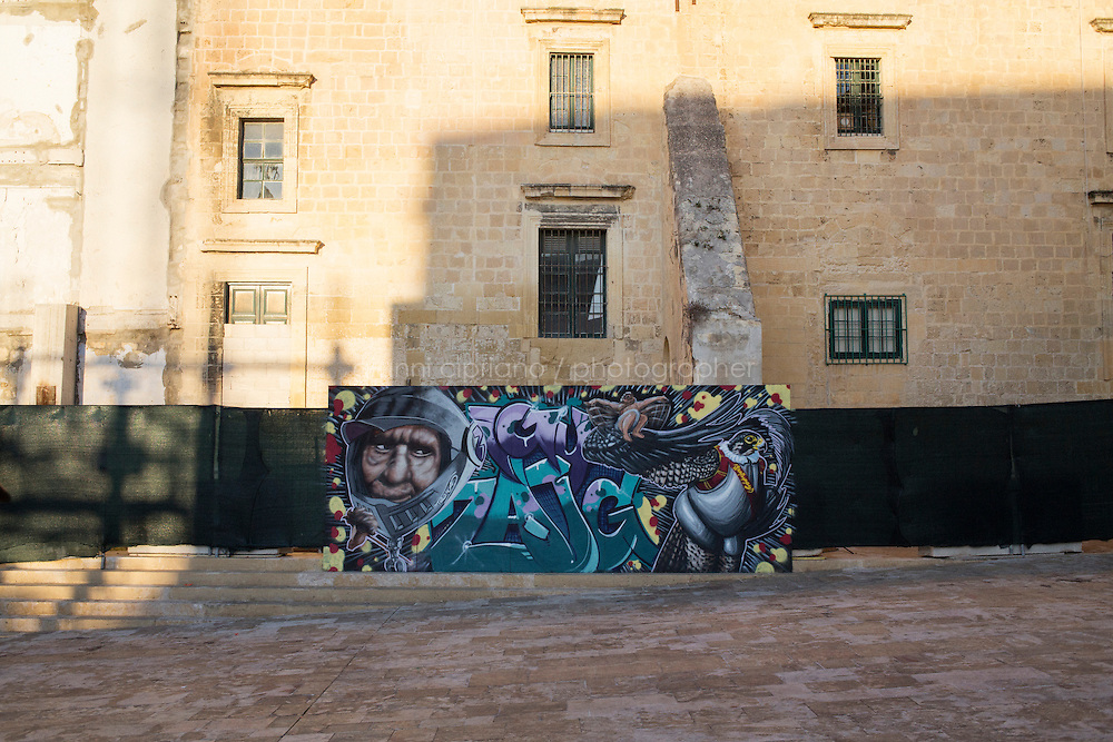 VALLETTA, MALTA - 3 November 2013: Street art in Jean de la Vallette square, in Valletta, Malta, on November 3rd 2013.<br /> <br /> Valleta was named after Jean Parisot de Valette of the Order of St. John of Jerusalem, who succeeded in defending the island from an Ottoman invasion in 1565, known as the Siege of Malta. The city was founded immediately after the end of the Siege of Malta to fortify the Order's position in Malta and bind the Knights to the island.