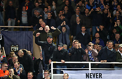 Club Brugge fans in the stands celebrate the result after the final whistle