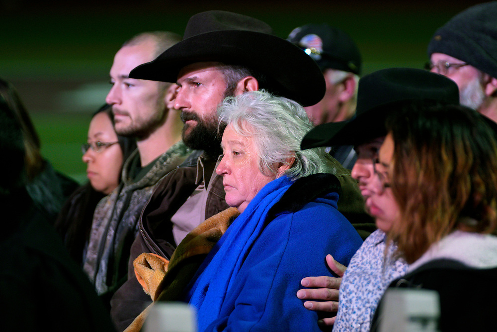Families of victims in the First Baptist Church of Sutherland Springs shooting listen at a prayer vigil in Floresville, Texas, November 8, 2017.  REUTERS/Rick Wilking