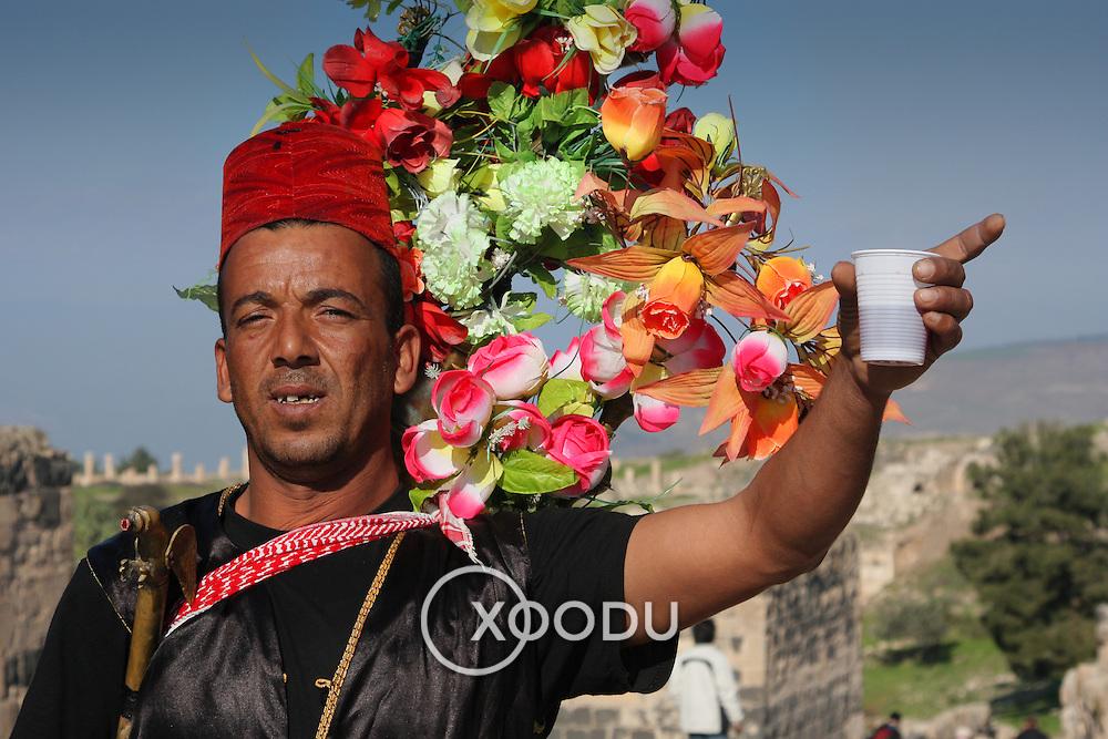 Costumed Jordanian hibiscus tea seller, Umm Qais (Gadara), Jordan (December 2007)