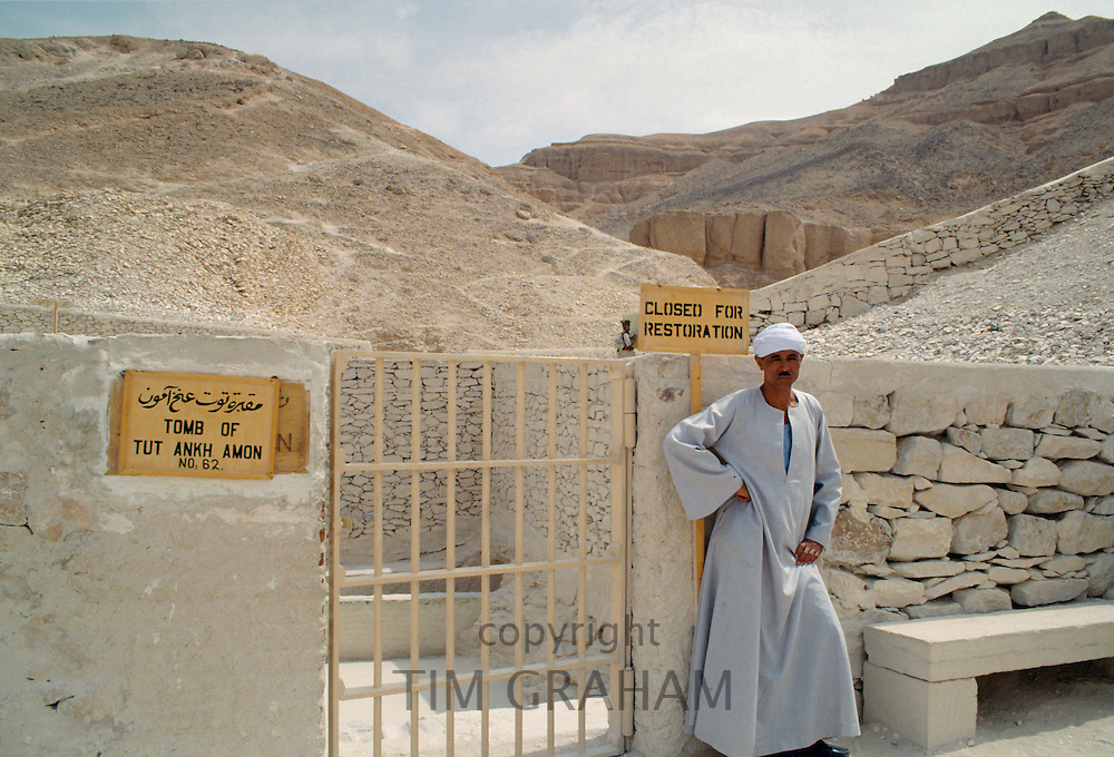 Guard at the Tomb of King Tutankhamun, Tut Ankh Amon, closed for restoration sign, Valley of the Kings, Luxor, Egypt, North Africa