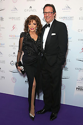 Joan Collins and Percy Gibson attending the Global Gift Gala held at The Corinthia Hotel in London.