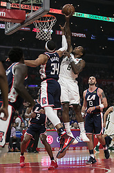 November 10, 2018 - Los Angeles, California, U.S - Eric Bledsoe #6 of the Milwaukee Bucks is blocked by Tobias Harris #34 of the Los Angeles Clippers during their NBA game on Saturday November 10, 2018 at the Staples Center in Los Angeles, California. Clippers defeat Bucks in OT, 128-126. (Credit Image: © Prensa Internacional via ZUMA Wire)