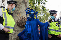 A blue rebel joins fellow climate activists from the Ocean Rebellion and Extinction Rebellion preparing to take part in a colourful Marine Extinction March on 6 September 2020 in London, United Kingdom. The activists, who are attending a series of September Rebellion protests around the UK, are demanding environmental protections for the oceans and calling for an end to global governmental inaction to save the seas.