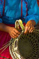 A Tarahumara Indian woman weaving a basket,  Uno Lodge, Copper Canyon (near San Rafael), Mexico
