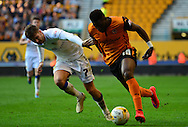 Bakary Sakho holds off Luke Murphy during the Sky Bet Championship match between Wolverhampton Wanderers and Leeds United at Molineux, Wolverhampton, England on 6 April 2015. Photo by Alan Franklin.