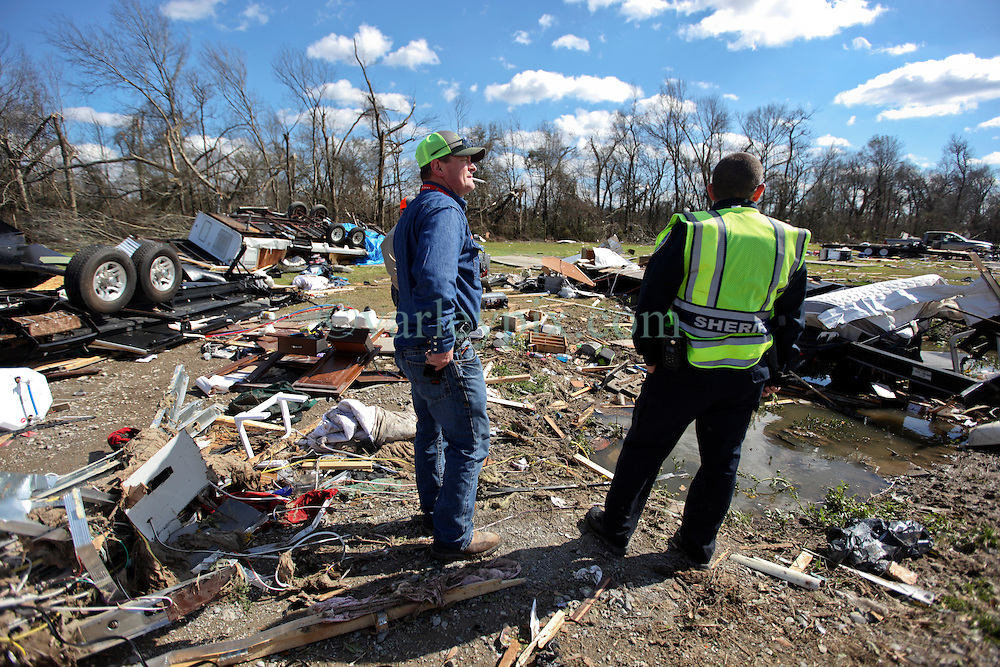24 February 2016. Sugar Hill RV Park, Convent, Louisiana.<br /> Scenes of devastation following a deadly EF2 tornado touchdown. 2 confirmed dead. <br /> Mark Hippard talks with a local sheriff as he attempts to rescue all he can from his smashed trailer. <br /> Photo©; Charlie Varley/varleypix.com