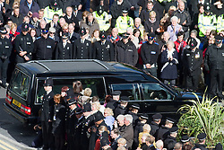 © Licensed to London News Pictures. 03/10/2012. Manchester, UK . The hearse carrying Nicola Hughes' coffin arrives at Manchester Cathedral . 100s of police and public line Deansgate in Manchester City Centre for the funeral of PC Nicola Hughes at Manchester Cathedral . Hughes was murdered in a gun and grenade attack alongside PC Fiona Bone when responding to a suspected burglary at a house in Hattersley in Tameside on 18th September . Dale Cregan is currently on remand , accused of their murder . Photo credit : Joel Goodman/LNP