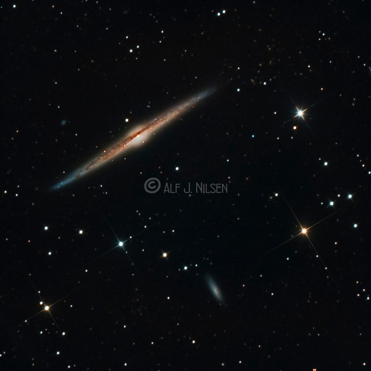 The edge-on spiral galaxy NGC4565 (Needle Galaxy) and the smaller  galaxy NGC 4562 in constellation Coma Berenices.