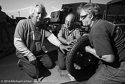 Doug Feinsod gets some help with the tire on his 1920 Henderson Deluxe in the hotel parking lot after stage 14 - (284 miles) of the Motorcycle Cannonball Cross-Country Endurance Run, which on this day ran from Meridian to Lewiston, Idaho, USA. Friday, September 19, 2014.  Photography ©2014 Michael Lichter.