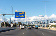 View through a vehicle windshield of the M1 (Monash) Freeway and the Melbourne city skyline in Melbourne, Australia. The entire stretch of the Monash Freeway bears the designation M1