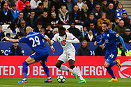 M'bate Niang of Watford © battles with Yohan Benalouane and Christian Fuchs of Leicester  city ®. Premier league match, Leicester City v Watford at the King Power Stadium in Leicester, Leicestershire on Saturday 6th May 2017.<br /> pic by Bradley Collyer, Andrew Orchard sports photography.