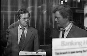 Fergus Rowan sits in at Bank of Ireland.  (J70)..1975..22.08.1975..08.22.1975..22nd August 1975..As a result of the 1970 bank strike which lasted for six months, the Rowan family business found itself in financial difficulties. During the strike the Rowans had had to accept cheques in good faith in order to stay in business. When the cheques came for settlement the bank refused as they stated that some were 'dodgy'. This put severe strain on the business which was eventually put into receivership.As part of the process the Rowan business beside the bank was put up for sale and was purchased by B.o I. Rowan was outraged and started a campaign against the bank which culminated in a sit in at the banks headquarters in Westmoreland St,Dublin. He also became a thorn in the side of the bank at the A.G.Ms raising many points...Picture shows a High Court Order being served on Fergus Rowan. The bank manager watches receipt of the order. The order was served to force Mr Rowan to vacate the premises.