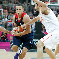 02 August 2012: Great Britain Andrew Lawrence drives past Spain Jose Calderon during 79-78 Team Spain victory over Team Great Britain, during the men's basketball preliminary, at the Basketball Arena, in London, Great Britain.