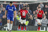 GOAL - Manchester United Midfielder Paul Pogba celebrates with Manchester United Midfielder Ashley Young 0-2 during the The FA Cup 5th round match between Chelsea and Manchester United at Stamford Bridge, London, England on 18 February 2019.