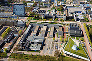Nederland, Zuid-Holland, Delft, 09-05-2013; overzicht Campus TU Delft met in de voorgrond de Delft TU bibliotheek (met grasdak, ontwerp Mecanoo) en de Aula annex Conferentie Centrum. Het gebouw met logo en rode gevel is van Elektrotechniek, Wiskunde en Informatica (EWI)..Overview of the Campus of the Delft University of Technology. In the foreground Library (Mecanoo  architects) and auditorium. The high-rise red-striped building is the faculty of Electrical Engineering, Mathematics and Computer Sciences (EEMCS)..luchtfoto (toeslag op standard tarieven).aerial photo (additional fee required).copyright foto/photo Siebe Swart