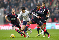 Tottenham Hotspur's Son Heung-Min (centre) and Huddersfield Town's Collin Quaner (second right) battle for the ball during the Premier League match at Wembley Stadium, London.