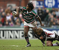 Photo: Rich Eaton.<br /> <br /> Leicester Tigers v Newcastle Falcons. Guinness Premiership. 27/01/2007. Matthew Tait of Newcastle Falcons tackles Seru Rabeni of Leicester