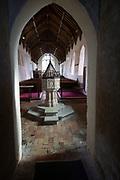 Baptismal font in church of Ilketshall St Andrew, Suffolk, England, UK