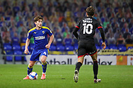 AFC Wimbledon midfielder Alex Woodyard (4) about to take on Lincoln City attacker Jorge Grant (10) during the EFL Sky Bet League 1 match between AFC Wimbledon and Lincoln City at Plough Lane, London, United Kingdom on 2 January 2021.