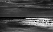 Surf breaking on rocky shoreline at Shellharbour, NSW, Australia,