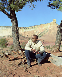 handsome man relaxing in the wilderness in Abiquiu, New Mexico