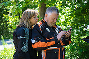 Phil and Kathrine Templeton check their iPhone during a break in the riding.