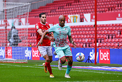 Andre Ayew of Swansea City chases a ball in the box, pursued by Yuri Ribeiro of Nottingham Forest - Mandatory by-line: Nick Browning/JMP - 29/11/2020 - FOOTBALL - The City Ground - Nottingham, England - Nottingham Forest v Swansea City - Sky Bet Championship