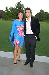ELLA KRASNER and ALEX McLEAN at 'Horticouture' a charity fashion show to raise funds for Tommy's, the baby charity and The Royal Botanic Gardens, Kew held at Kew on 12th May 2005.<br /><br />NON EXCLUSIVE - WORLD RIGHTS
