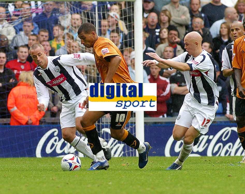 Photo: Dave Linney.<br />West Bromwich Albion v Wolverhampton Wanderers. Coca Cola Championship. 22/10/2006. Wolves midfielderJay Bothroyd (c) tries to find a way through the Albion defence.