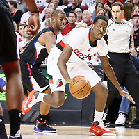 25 April 2016: Portland Trail Blazers forward Al-Farouq Aminu (8) drives past Los Angeles Clippers guard Chris Paul (3) during the Portland Trail Blazers 98-84 victory over the Los Angeles Clippers, during Game Four of the Western Conference Quarterfinals of the NBA Playoffs at the Moda Center, Portland, Oregon, USA.