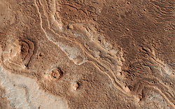 January 29, 2018 - Mars Surface - Layers, probably sedimentary in origin, have undergone extensive erosion in this image from NASA's Mars Reconnaissance Orbiter (MRO) of Shalbatana Valles, a prominent channel that cuts through Xanthe Terra. This erosion has produced several small mesas and exposed light-toned material that may differ in composition from the surrounding material. (Credit Image: © JPL-Caltech/NASA via ZUMA Wire/ZUMAPRESS.com)