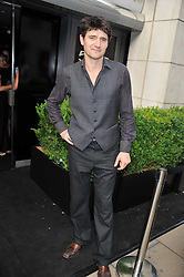 TOM CHAMBERS at a party to launch the Gucci designed Fiat 500 customized by Gucci Creative Director Frida Giannini in collaboration with FIAT's Centro Stile, held at Fiat, 105 Wigmore Street, London on 27th June 2011.