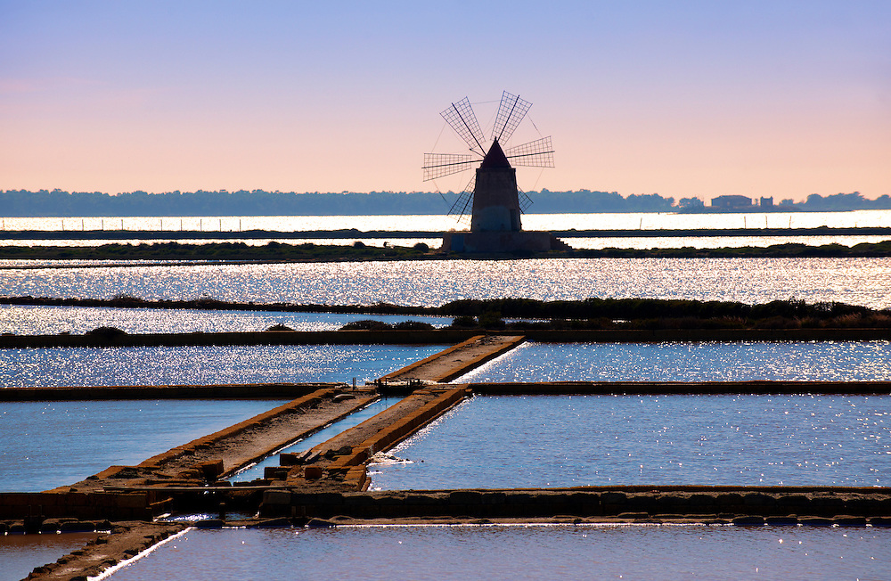 Ettore Infesera windmill on the sea salt making pans , Masala Sicily. travel stock photos .<br /> <br /> Visit our SICILY PHOTO COLLECTIONS for more   photos  to download or buy as prints https://funkystock.photoshelter.com/gallery-collection/2b-Pictures-Images-of-Sicily-Photos-of-Sicilian-Historic-Landmark-Sites/C0000qAkj8TXCzro<br /> If you prefer to buy from our ALAMY PHOTO LIBRARY  Collection visit : https://www.alamy.com/portfolio/paul-williams-funkystock/trapanimaslalasaltpans.html .<br /> <br /> Visit our SICILY HISTORIC PLACES PHOTO COLLECTIONS for more   photos  to download or buy as prints https://funkystock.photoshelter.com/gallery-collection/2b-Pictures-Images-of-Sicily-Photos-of-Sicilian-Historic-Landmark-Sites/C0000qAkj8TXCzro<br /> .<br /> <br /> Visit our EARLY MODERN ERA HISTORICAL PLACES PHOTO COLLECTIONS for more photos to buy as wall art prints https://funkystock.photoshelter.com/gallery-collection/Modern-Era-Historic-Places-Art-Artefact-Antiquities-Picture-Images-of/C00002pOjgcLacqI