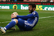 Cesc Fabregas of Chelsea reacts and holds his leg in pain after taking a knock. Premier league match, Stoke City v Chelsea at the Bet365 Stadium in Stoke on Trent, Staffs on Saturday 18th March 2017.<br /> pic by Andrew Orchard, Andrew Orchard sports photography.